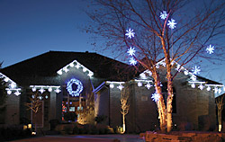 Holiday Lighting House Example from Brite Ideas with snowflake lights, white tree lights and lighted wreath